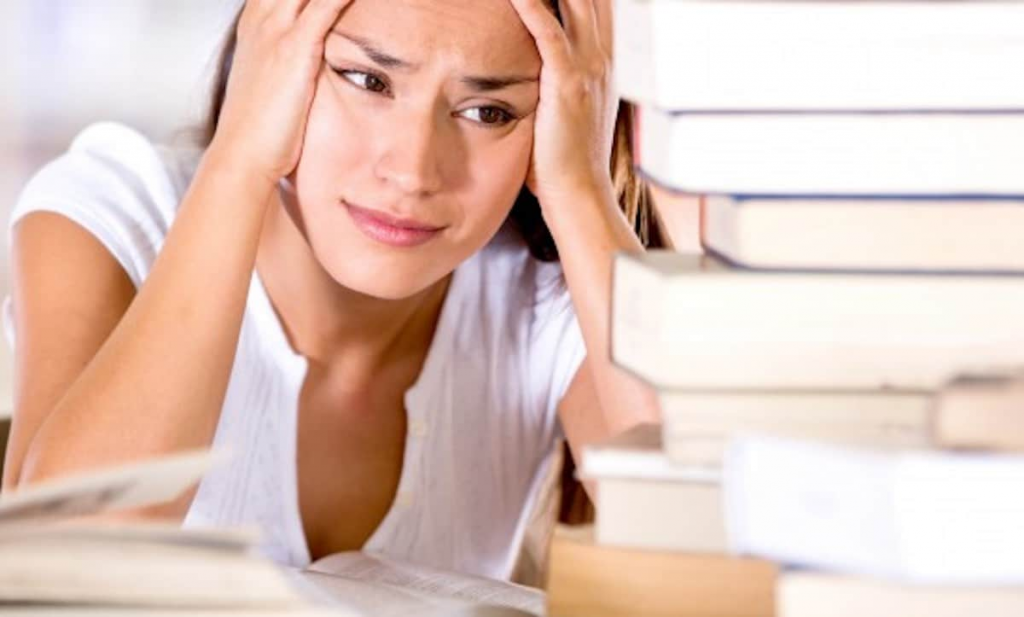 an exhausted student wonders how not to get caught using paper help